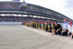 Victory lane: race winner Paul Menard, Richard Childress Racing Chevrolet celebrates with his team by kissing the yard of bricks