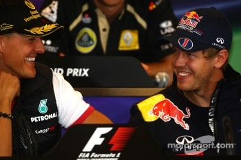 Michael Schumacher, Mercedes GP and Sebastian Vettel, Red Bull Racing