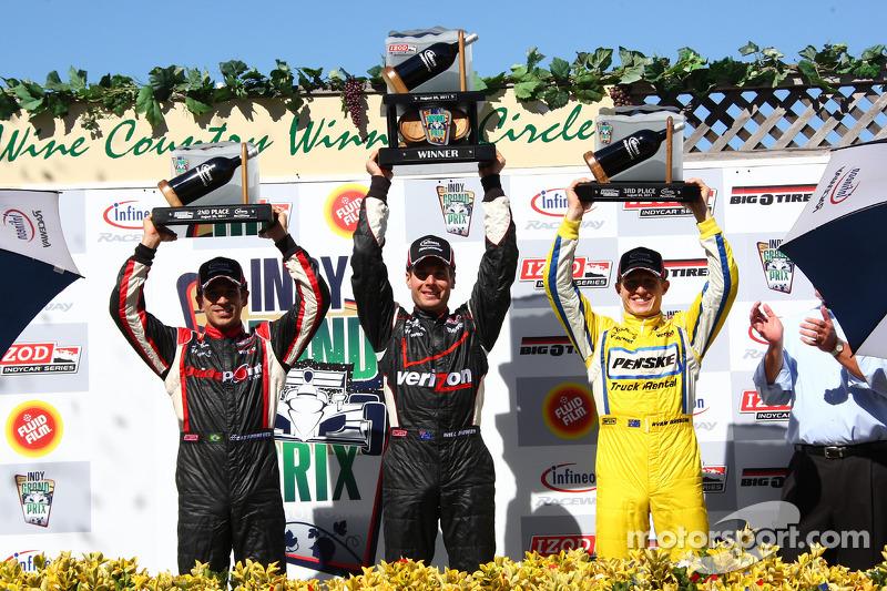 Podium: race winner Will Power, Team Penske, second place Helio Castroneves, Team Penske, third place Ryan Briscoe, Team Penske