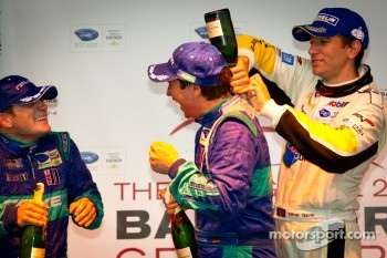 GT podium: class winner Wolf Henzler gets sprayed with champagne