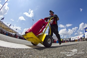 Clint Bowyer's team member pushes a Sunoco fuel can