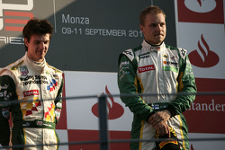 Valtteri Bottas celebrates victory in the race and winning the drivers championship on the podium with James Calado