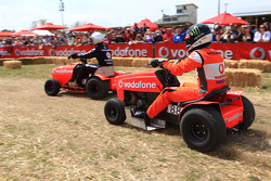 Jamie Whincup takes part in a lawn mower race