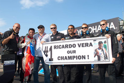 Ricardo Vera celebrates the season championship with the team