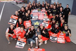 Race winners Garth Tander and Nick Percat celebrate with team