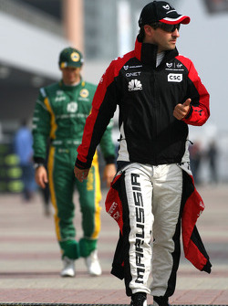 Timo Glock, Virgin Racing and Jarno Trulli, Team Lotus