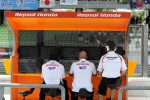 The Respol Honda team looks on