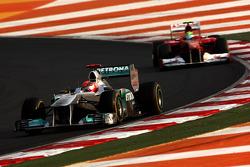 Michael Schumacher, Mercedes GP Petronas F1 Team leads Felipe Massa, Scuderia Ferrari