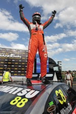 Race winner Jamie Whincup celebrates