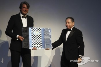 FIA President Jean Todt presents a Formula One Promotional Trophy
