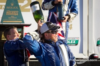 DP podium: A.J. Allmendinger celebrates with Michael Shank