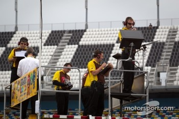 Joe Gibbs Racing Toyota team members watch practice session