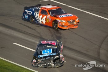 Eric McClure, TriStar Motorsport Toyota and David Ragan, Front Row Motorsports Ford after a crash