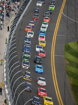 Joe Nemechek, Nemco Motorsports Toyota and Sam Hornish Jr., Penske Racing Dodge lead the field
