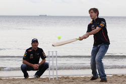 Sebastian Vettel, Red Bull Racing and Mark Webber, Red Bull Racing playing cricket on the beach