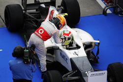 Third placed Lewis Hamilton, McLaren congratulates second placed Sergio Perez, Sauber in parc ferme