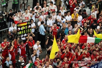 Ferrari celebrate victory in parc ferme with Sauber and McLaren