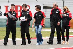 Timo Glock, Marussia F1 Team walks the circuit with Maria De Villota, Marussia F1 Team Test Driver