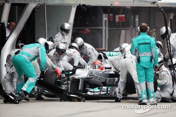 Michael Schumacher, Mercedes AMG F1 makes a pit stop that led to his retirement when a wheel was not securely attached to the car