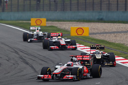 Jenson Button, McLaren leads Kimi Raikkonen, Lotus