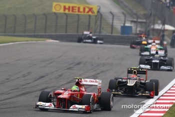 Felipe Massa, Ferrari leads Romain Grosjean, Lotus F1