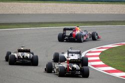 Mark Webber, Red Bull Racing leads Romain Grosjean, Lotus F1