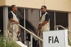 Security guards outside the FIA paddock building