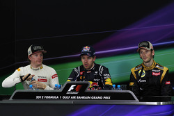 Top three in the FIA Press Conference, Lotus F1 Team, second; Sebastian Vettel, Red Bull Racing, race winner; Romain Grosjean, Lotus F1 Team, third