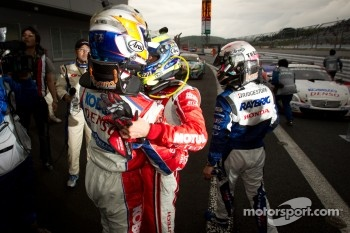 GT500 race winner Hiroaki Ishiura celebrates with Satoshi Motoyama