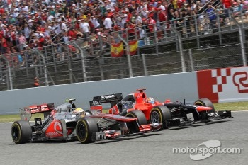 Timo Glock, Marussia F1 Team is passed by Lewis Hamilton, McLaren