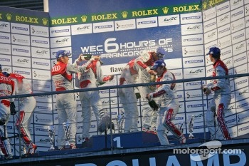 LMP1 Podium: race winners, Romain Dumas, Loic Duval, Marc Gene; second place, Allan McNish, Tom Kristensen, Rinaldo Capello; third place, Oliver Jarvis, Marco Bonanomi