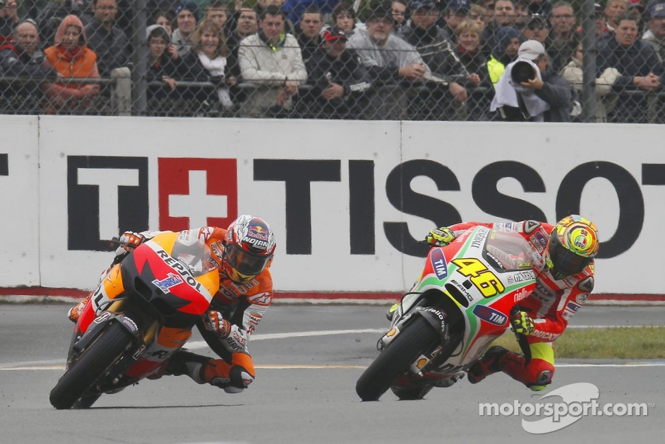 Casey Stoner, Repsol Honda Team and Valentino Rossi, Ducati Marlboro Team