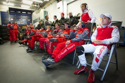 Christopher Mies and Audi Sport Team Phoenix team members watch the race