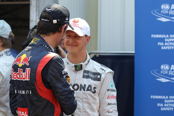 Mark Webber, Red Bull Racing and Michael Schumacher, Mercedes AMG Petronas