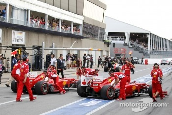Fernando Alonso, Scuderia Ferrari and team mate Felipe Massa, Scuderia Ferrari in the pits