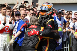 Romain Grosjean, Lotus F1 Team celebrates his second position in parc ferme