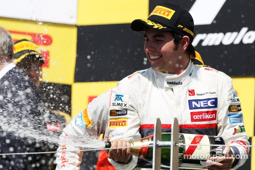 Sergio Perez, Sauber celebrates his third position on the podium