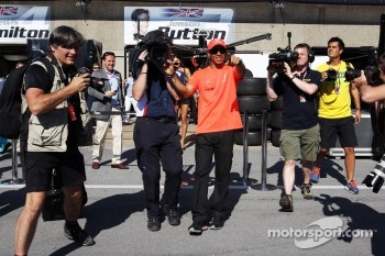 Lewis Hamilton, McLaren Mercedes guides the Sky F1 cameraman