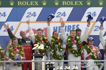 LMP1 podium: class and overall winners Marcel Fässler, Andre Lotterer, Benoit Tréluyer