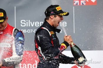 Podium: race winner Antonio Felix Da Costa is dosed in champagne by second place Mitch Evans
