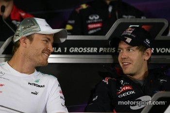Nico Rosberg, Mercedes GP and Sebastian Vettel, Red Bull Racing