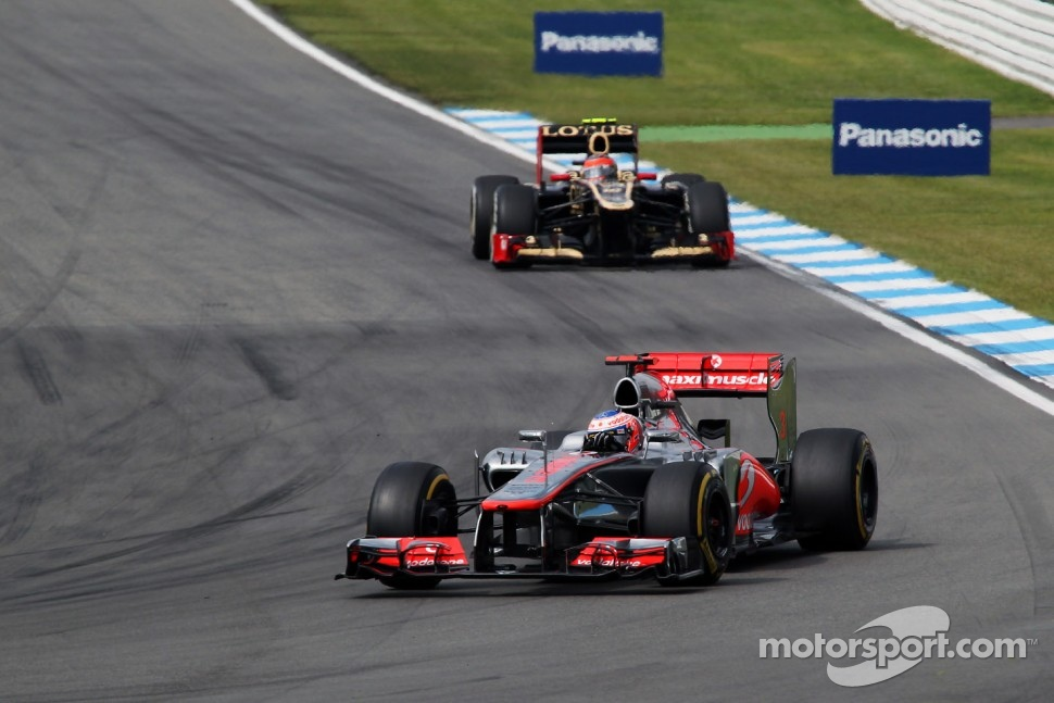 Jenson Button, McLaren leads Romain Grosjean, Lotus F1