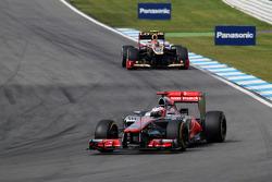 Jenson Button, McLaren leads Romain Grosjean, Lotus F1