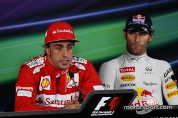 Pole sitter Fernando Alonso, Scuderia Ferrari and Mark Webber, Red Bull Racing in the FIA Press Conference