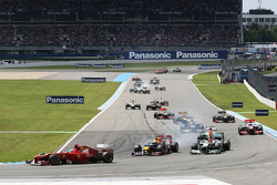 Fernando Alonso, Ferrari leads at the start of the race as Sebastian Vettel, Red Bull Racing and Michael Schumacher, Mercedes AMG F1 battle for second position