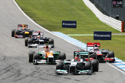 Michael Schumacher, Mercedes AMG F1 lrads Nico Hulkenberg, Sahara Force India F1 and Jenson Button, McLaren