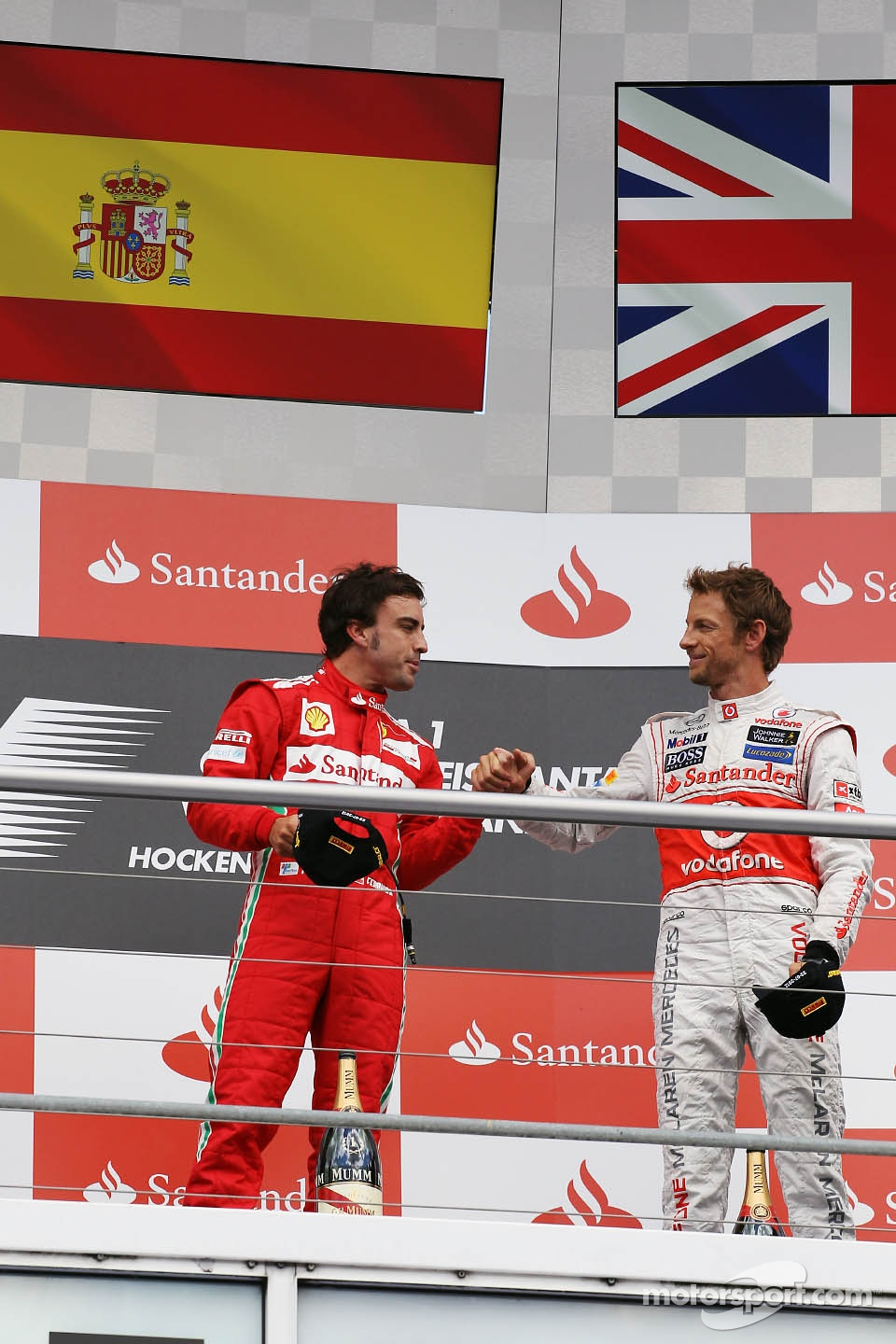 Podium: Fernando Alonso, Scuderia Ferrari celebrates with third placed Jenson Button, McLaren