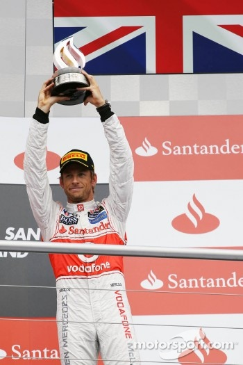 Jenson Button, McLaren celebrates his third position on the podium