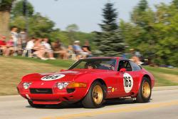 Race Cars parade into Elkhart Lake for the Friday Concours.  #165 1969 Ferrari 365 GTB/4: David Hinton