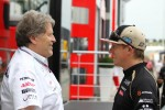 Norbert Haug, Mercedes Sporting Director with Kimi Raikkonen, Lotus F1 Team